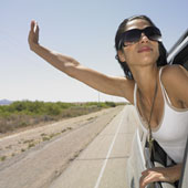 woman leaning out car window